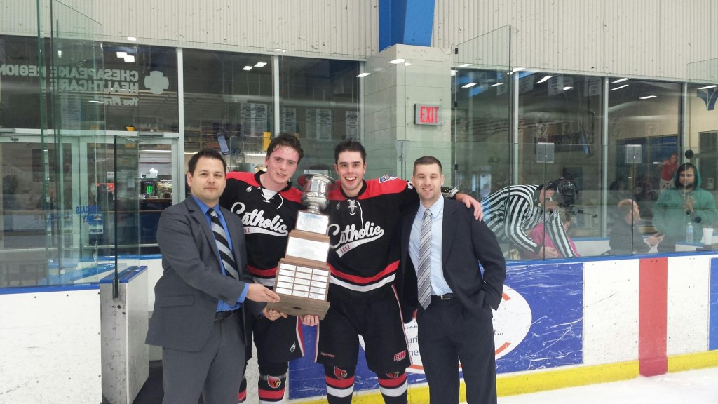 CUA Ice Hockey poses with their championship trophy Photo Credit: Charles Hostovsky