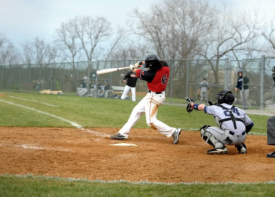 Freshman infielder Ryan Tracy drives a single into right field. Courtesy of CUACardinals.com
